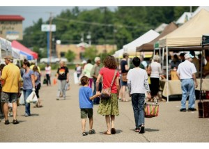 Customers walk down the main walkway during the Athens Farmers Market.
